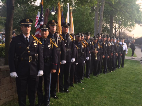 Line of Police Officers Standing in Dress Uniform